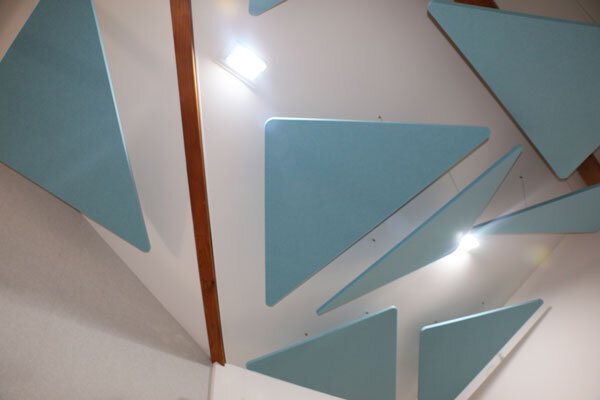 floating acoustic panels installed in office ceiling to prevent echo