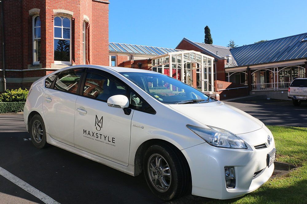 Max Style company vehicle parked in front of Catholic Diocese of Auckland